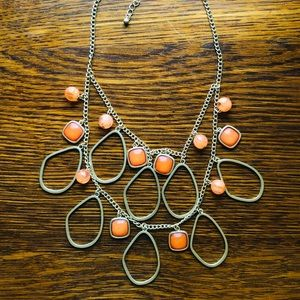 Gold tone necklace with orange accents